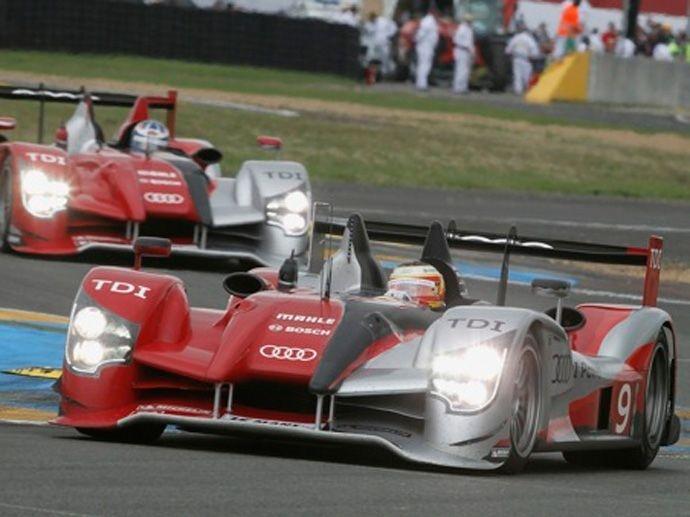 2010. Le Mans' Winner Audi Sport North America Mike RockenfellerTimo BernhardRomain Dumas