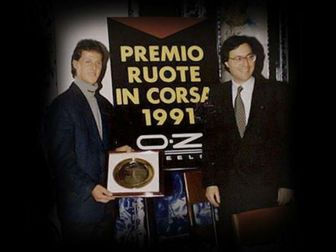 """1987. OZ start de """"Racing Wheels"""" titel, met het doel om talentvolle coureurs te stimmuleren. Gordon Murray (1988), Carlos Sainz (1990), Michael Schumacher (1991), Jacques Villeneuve (1994) en Frank Williams (1996)…"""